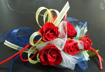 Red Sweetheart Roses with blue, yellow and white accents from local Myrtle Beach florist, Bright & Beautiful Flowers